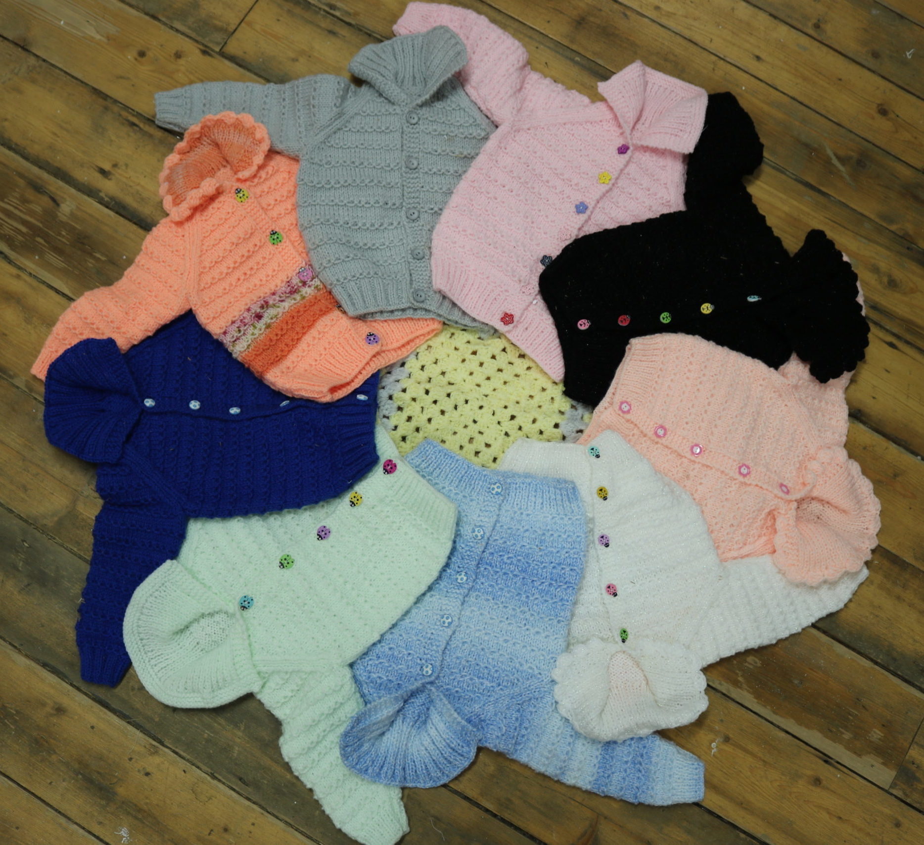 A wonderful array of hand knitted cardigans